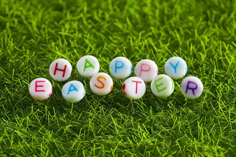 Happy Easter - colorful lettering on a green background stock photos