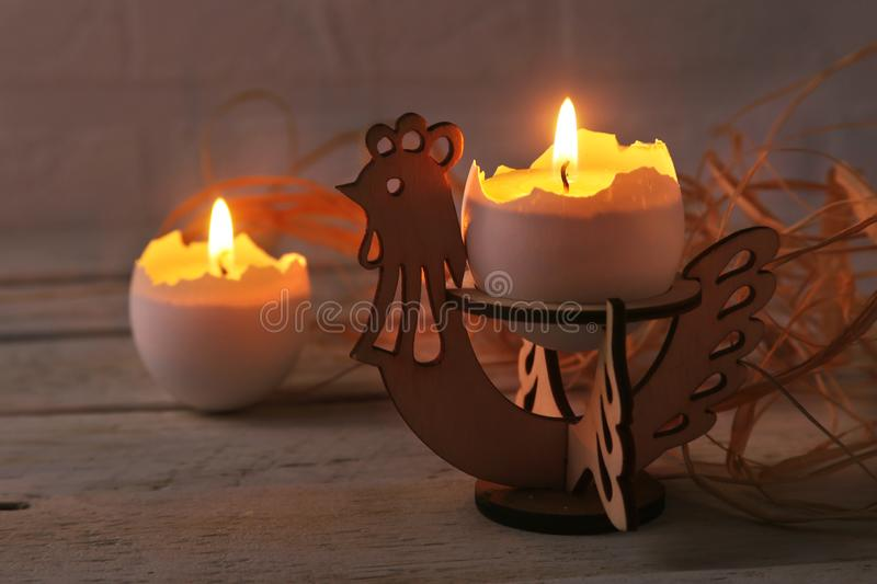 Happy easter composition with eggs and candles on Rustic background. Selective focus. stock photography