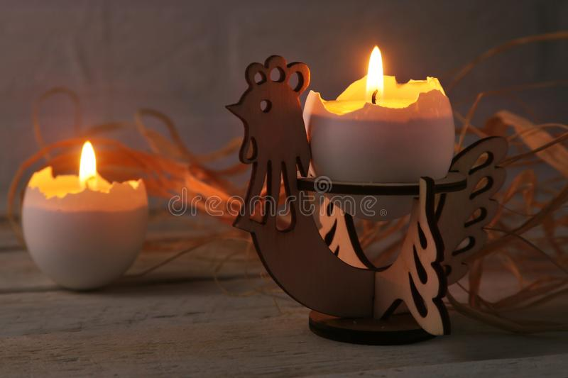 Happy easter composition with eggs and candles on Rustic background. Selective focus. stock images