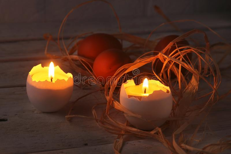 Happy easter composition with eggs and candles on Rustic background. Selective focus. stock photos