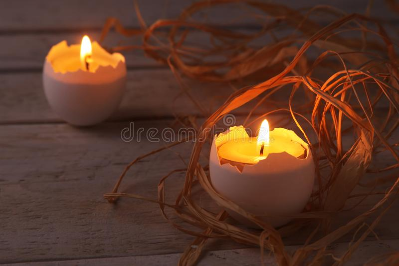 Happy easter composition with eggs and candles on Rustic background. Selective focus. stock image