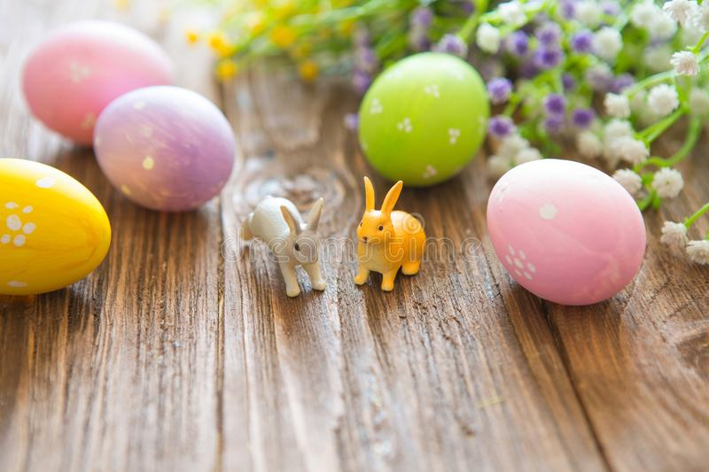 Happy Easter concept. Easter rabbit with Easter eggs on wooden background. Close-up stock photography