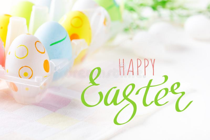 Happy Easter. Congratulatory easter background. Easter eggs and flowers. royalty free stock photography