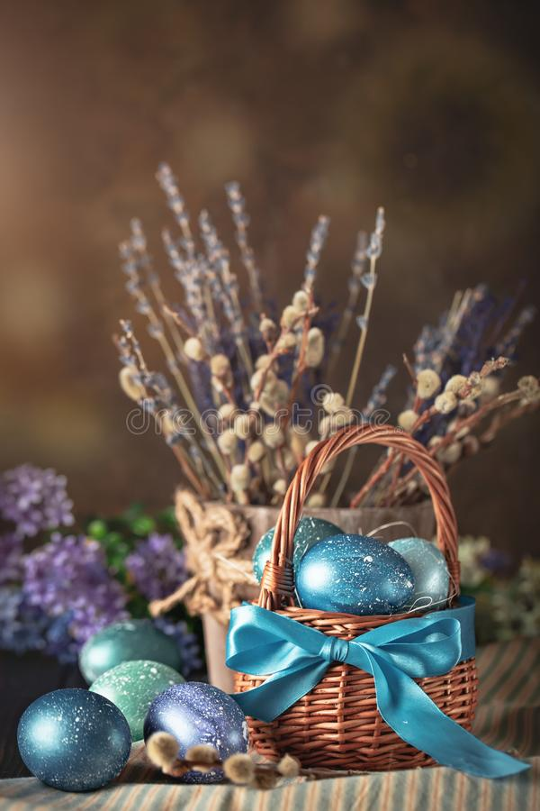 Happy Easter. Congratulatory easter background. Easter eggs and flowers. Background with copy space. Selective focus. royalty free stock photography