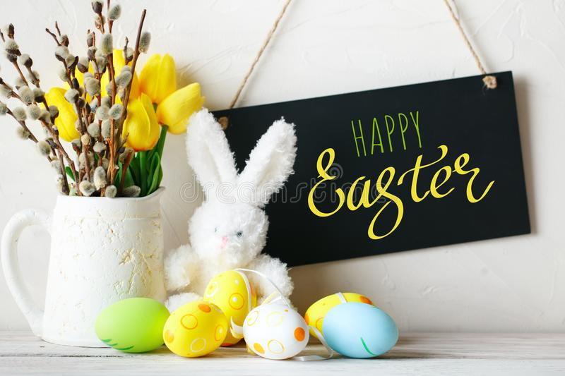 Happy Easter. Congratulatory easter background. Easter eggs and rabbit. royalty free stock images