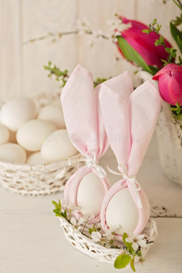 Happy easter. Decor of Easter eggs in small white baskets. royalty free stock images