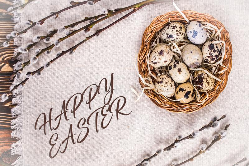 Happy Easter background with eggs in a basket and pussy-willow royalty free stock image