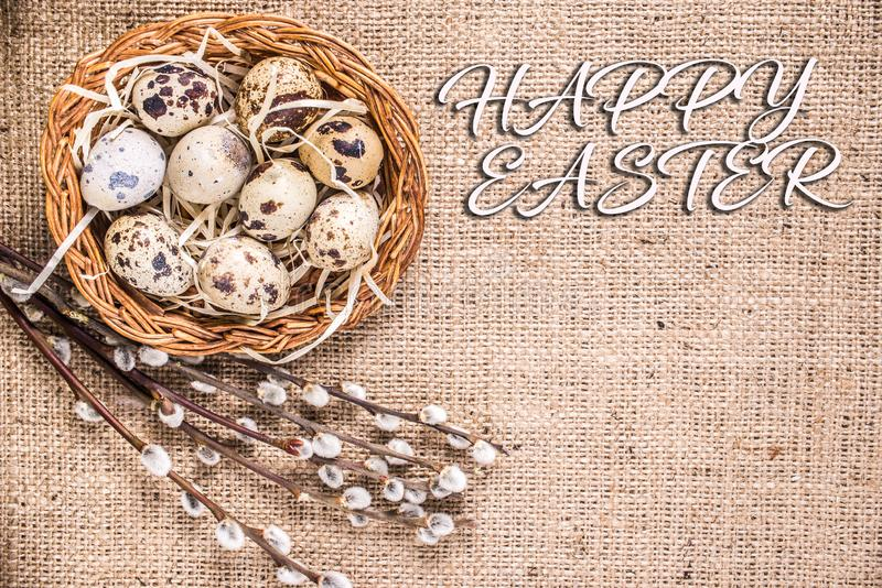 Happy Easter background with eggs in a basket and pussy-willow royalty free stock photo