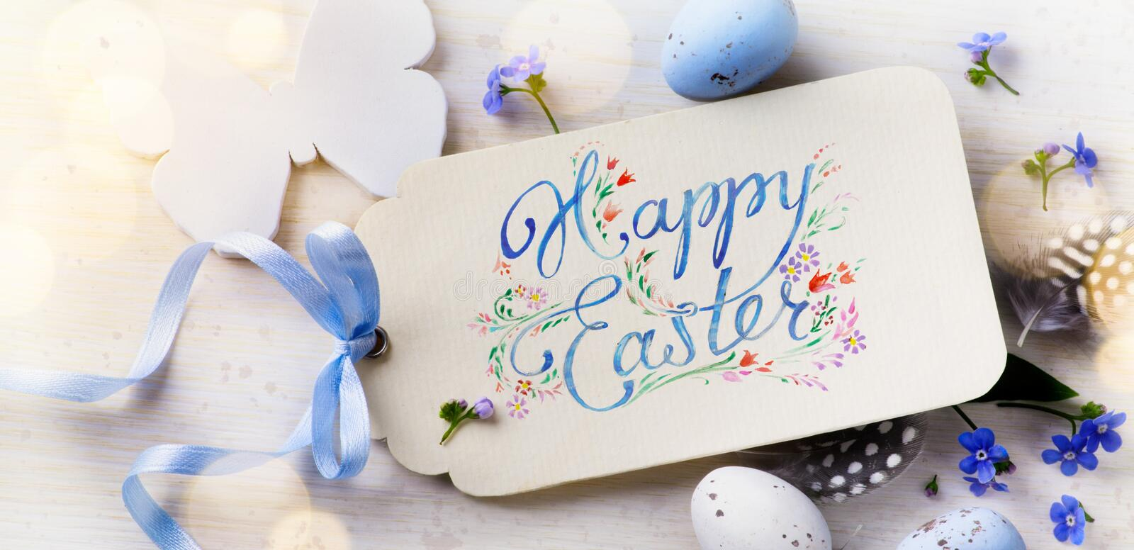 Happy Easter;Easter eggs and spring flovers. Easter card; Easter eggs and spring flovers on wood background stock images