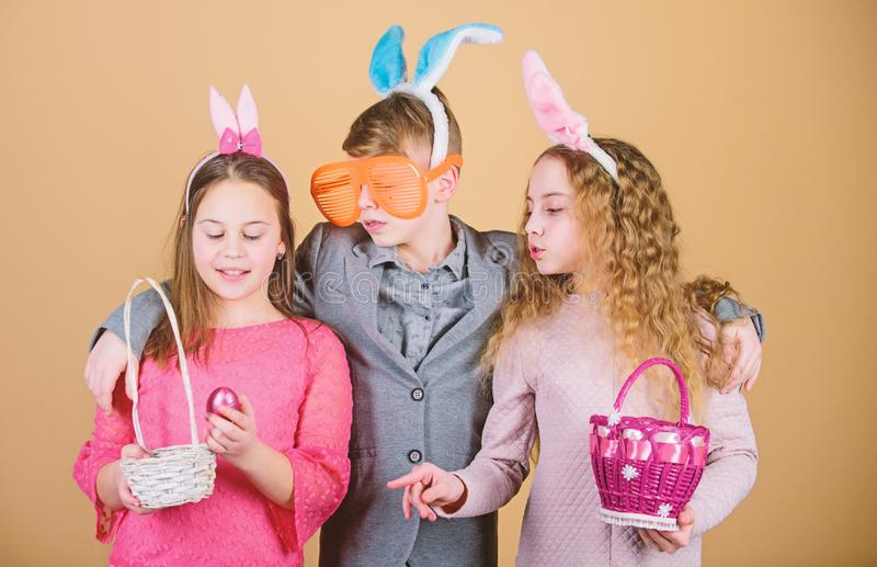 Happy easter. Egg hunt. Family and sisterhood. Little girls and boy with busket. Spring holiday party. Children in. Rabbit bunny ears. Easter vibes. Easter is royalty free stock image
