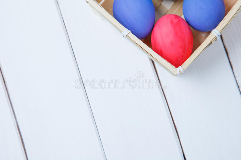 Happy Easter eggs in basket royalty free stock photos