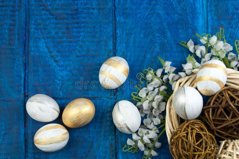 Happy Easter. eggs isolated on wooden table background.. Balls, wreath woven from the vines. Copy space for text. Top royalty free stock images
