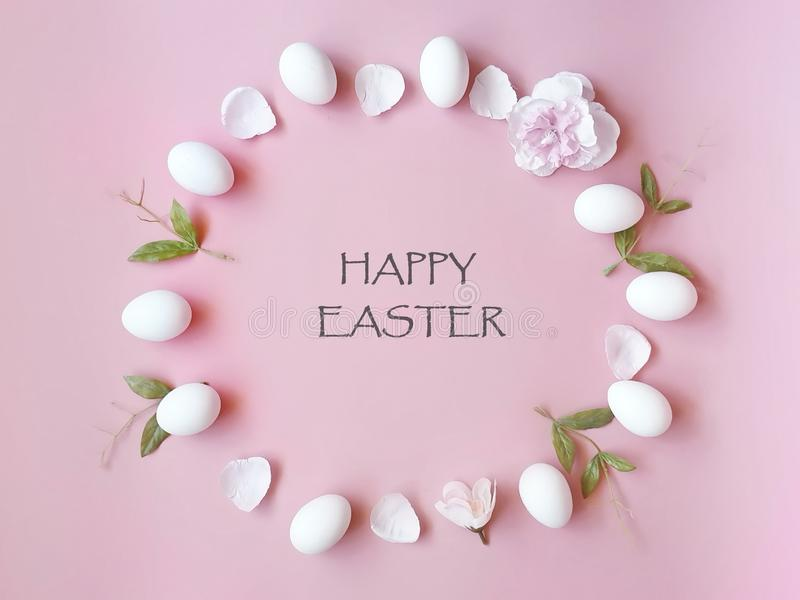 Happy Easter Eggs spring holiday with spring flowers petal and yellow copy space on pink background concept copy space royalty free stock photos