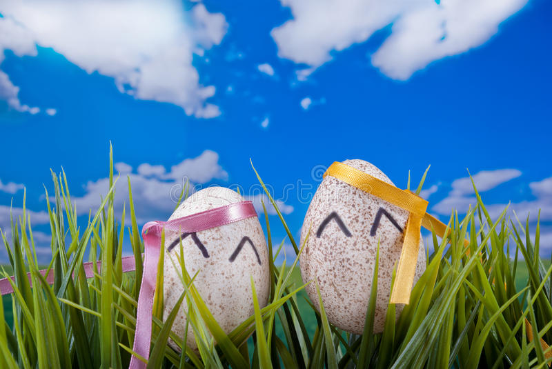Happy Easter Eggs. Two Easter eggs with smiling eyes in natural background stock photography