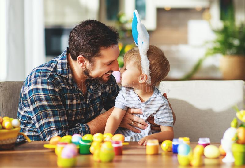 Happy easter! family father and child with ears hare getting ready for holiday. Happy easter! family father and child son with ears hare getting ready for royalty free stock photography