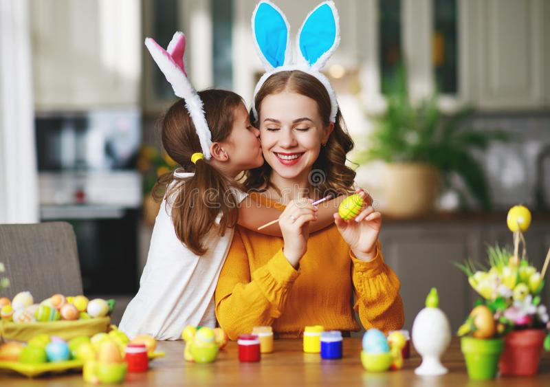 Happy easter! family mother and child with ears hare getting ready for holiday. Happy easter! family mother and child daughter with ears hare getting ready for stock photo