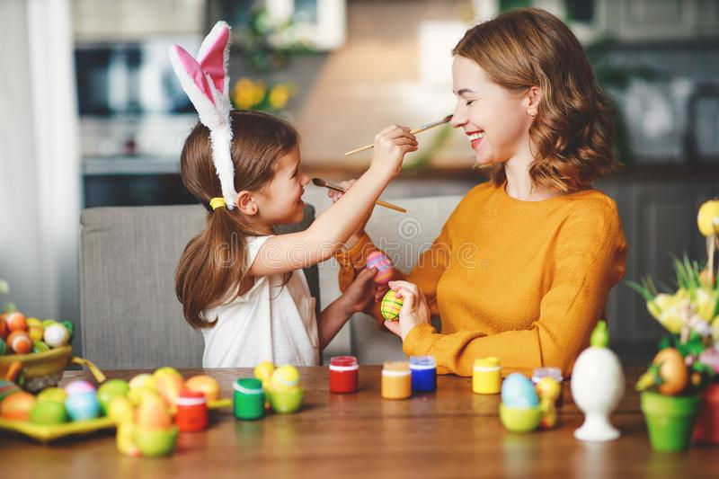 Happy easter! family mother and child with ears hare getting ready for holiday. Happy easter! family mother and child daughter with ears hare getting ready for stock photos