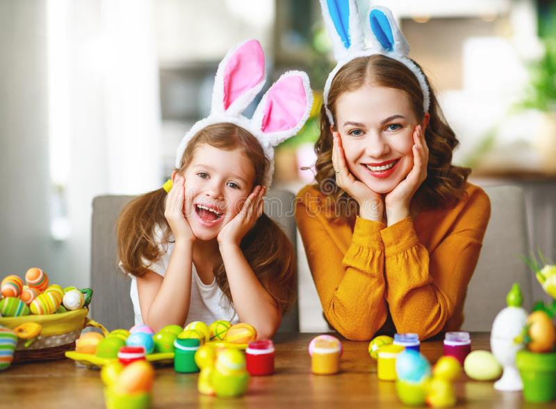 Happy easter! family mother and child with ears hare getting ready for holiday. Happy easter! family mother and child daughter with ears hare getting ready for royalty free stock photography