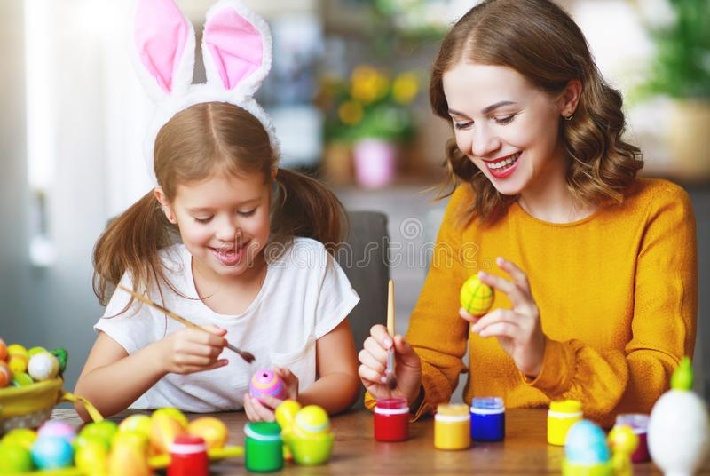 Happy easter! family mother and child with ears hare getting ready for holiday. Happy easter! family mother and child daughter with ears hare getting ready for stock image