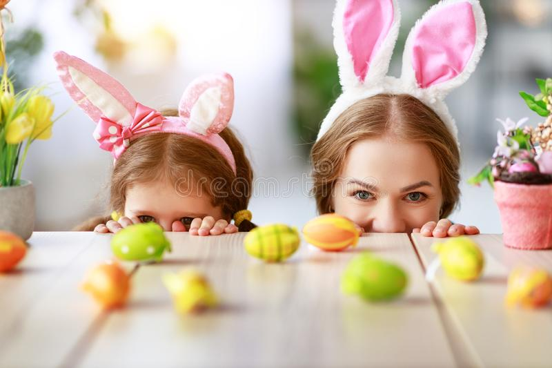 Happy easter! family mother and child with ears hare getting ready for holiday. Happy easter! family mother and child daughter with ears hare getting ready for royalty free stock photos