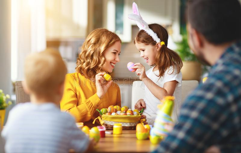 Happy easter! family mother, father and children paint eggs for holiday. Happy easter! family mother, father and children paint eggs for the holiday royalty free stock photo