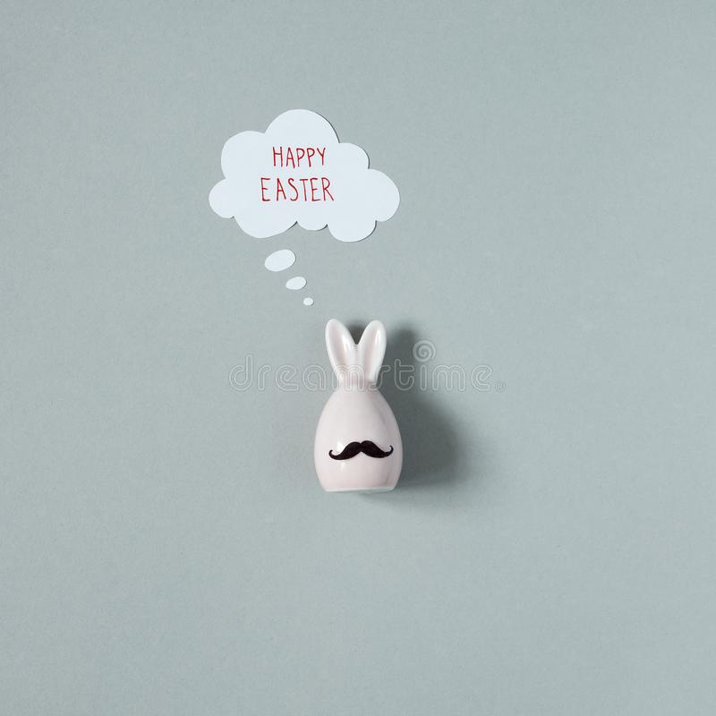 Happy Easter. Funny easter bunny with mustache on gray background.  royalty free stock images
