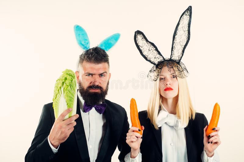 Happy easter and funny easter day. Funny easter bunny coupe. Two funny rabits. Funny couple in banny ears. royalty free stock photography