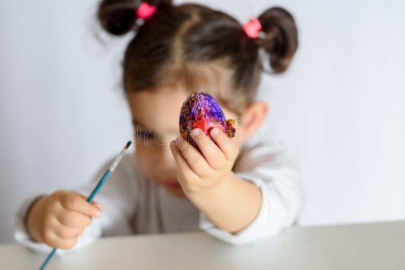 Colouring eggs for easter time at home. royalty free stock photos