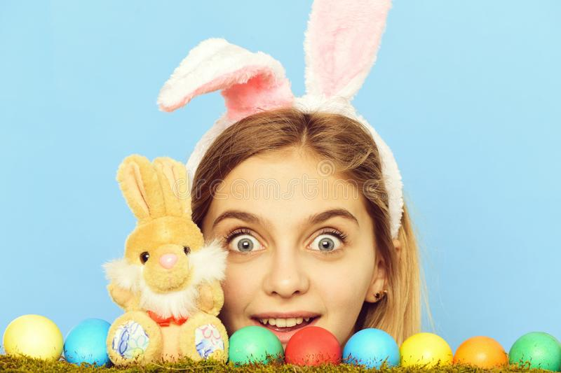 Happy easter girl in bunny ears with colorful eggs, rabbit stock photos