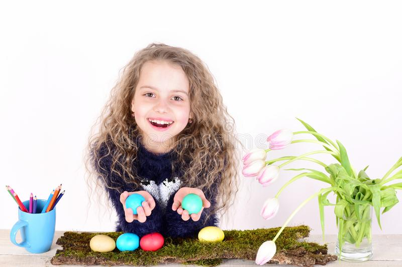 Happy easter girl with pencils, colorful eggs and tulip flowers stock image