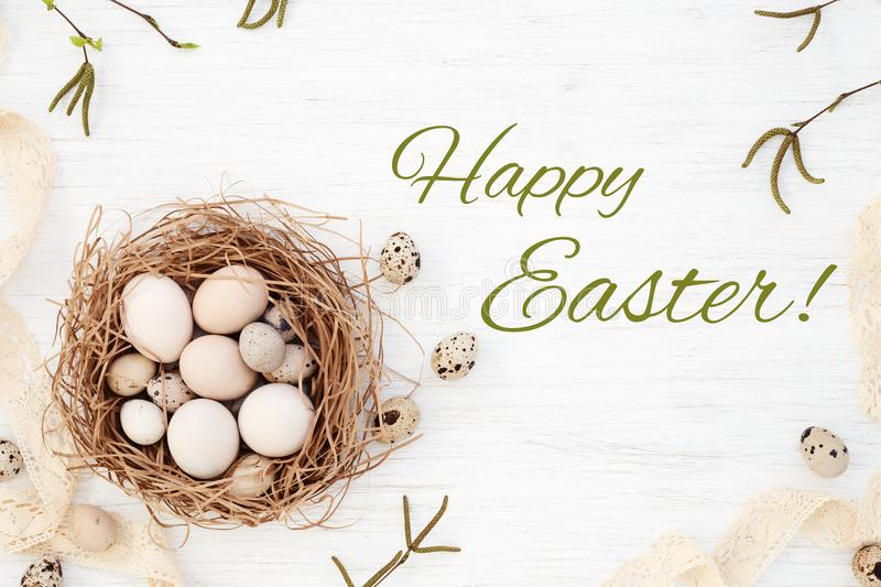 Happy Easter greeting card with Easter eggs in the nest royalty free stock photography