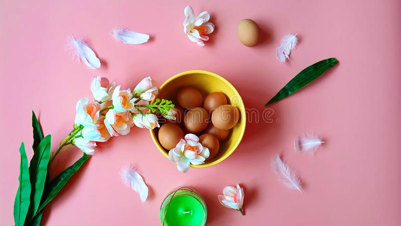 Eggs protein  Pink white apple flowers  green aroma  candle yellow plate on pink  Healthy  f. Happy Easter greetings card Holiday ,healthy Food ,Eggs Red stock photos