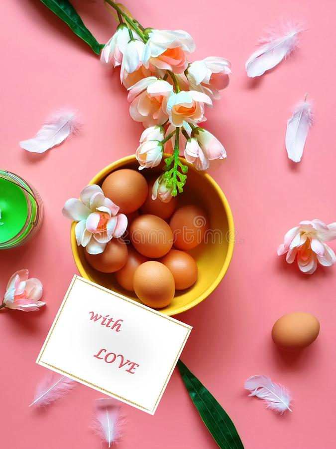 Easter Greetings card Eggs Pink white apple flowers green aroma candle yellow plate on pink Healthy f. Happy Easter greetings card Holiday ,healthy Food ,Eggs stock photo