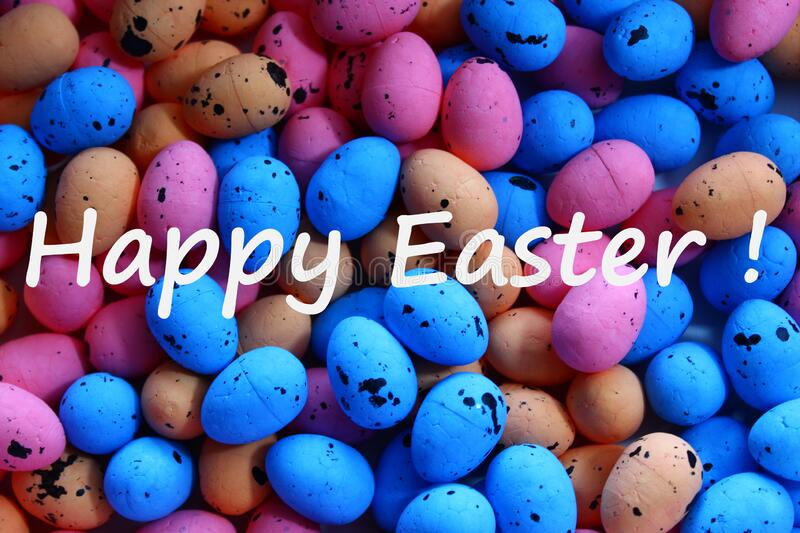 Happy easter greetings with many colourful eastereggs. The picture happy easter greetings with many colourful eastereggs stock photo