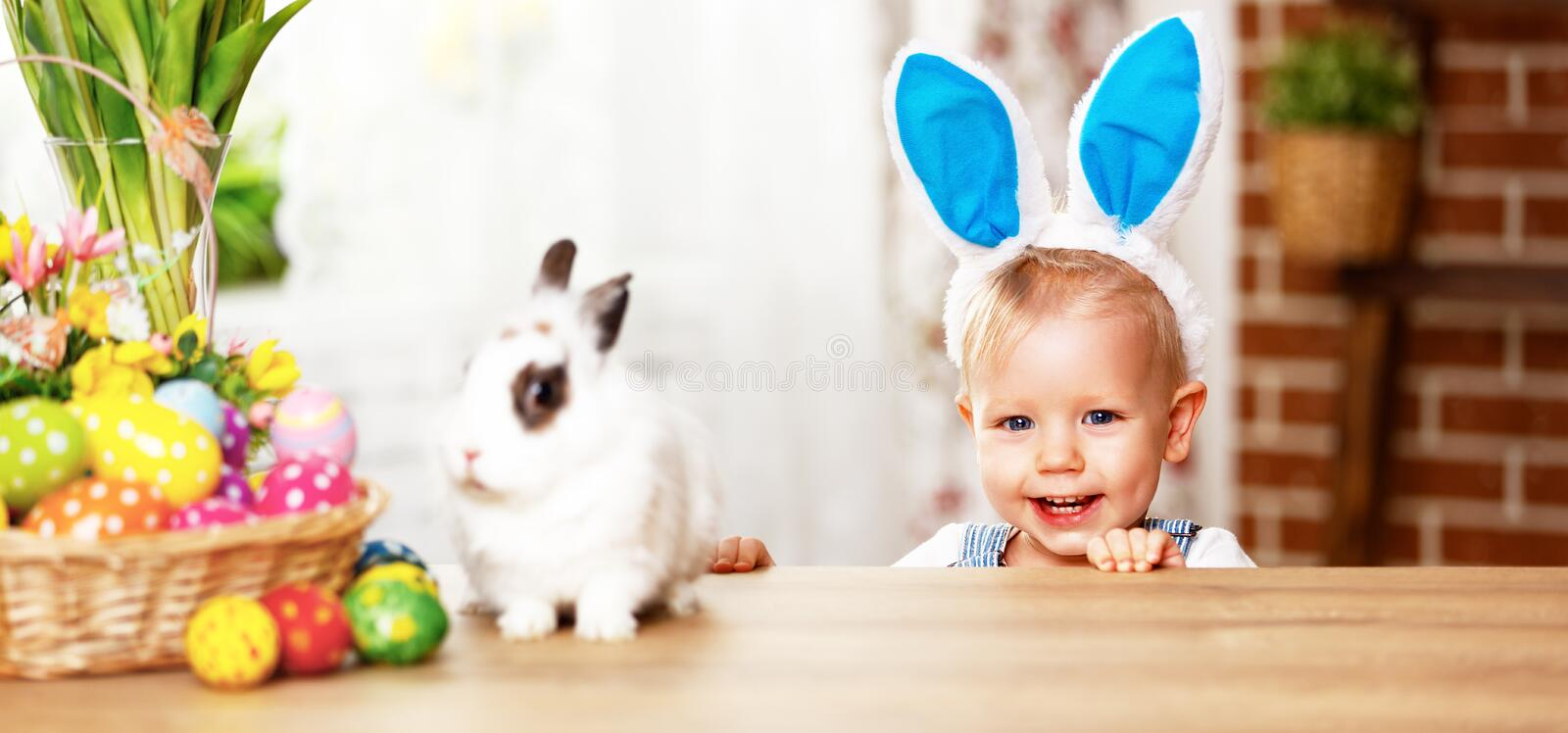Happy easter! happy funny baby boy playing with bunny. Happy easter! happy funny baby boy playing with Easter bunny royalty free stock images