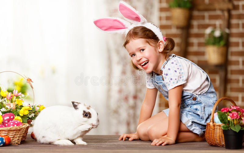 Happy easter! happy funny child girl playing with bunny. Happy easter! happy funny child girl playing with Easter bunny stock photography