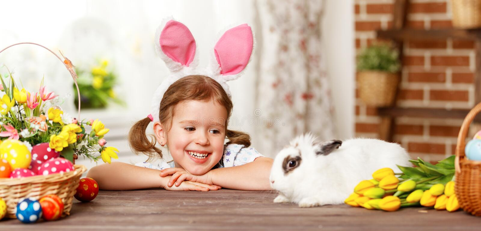 Happy easter! happy funny child girl playing with bunny. Happy easter! happy funny child girl playing with Easter bunny stock photos