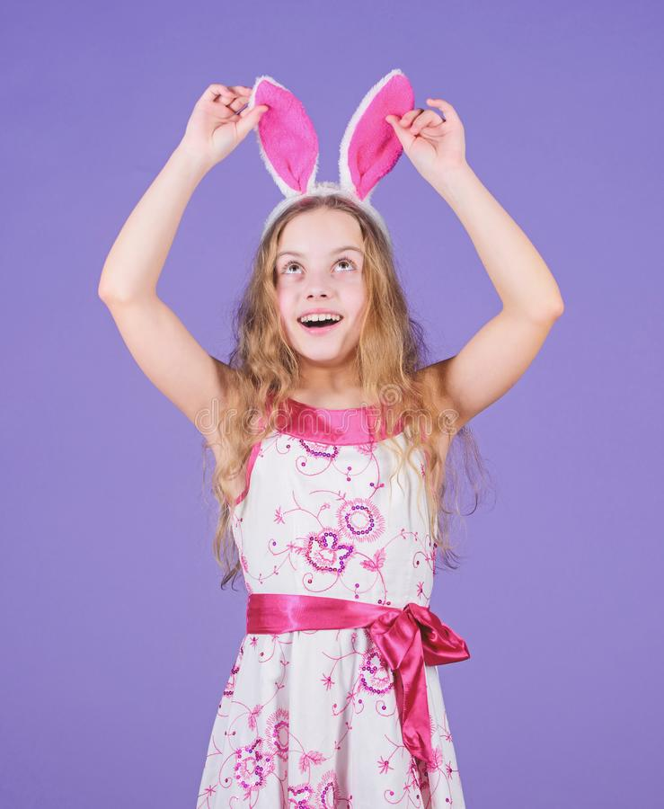 Happy easter. Holiday bunny girl with long bunny ears. Child cute bunny costume. Playful baby celebrate easter. Spring. Holiday. Happy childhood. Ready for royalty free stock photo