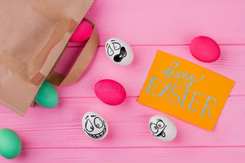 Happy Easter inscription and eggs. royalty free stock image