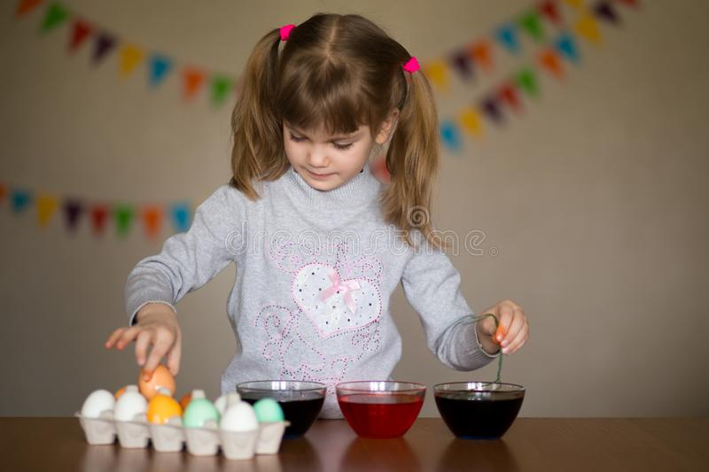 Happy easter. Little girl painter painted eggs. Kid preparing for Easter. Painted hand. Art and craft concept. Tradi. Happy easter. Little girl painter painted royalty free stock photography