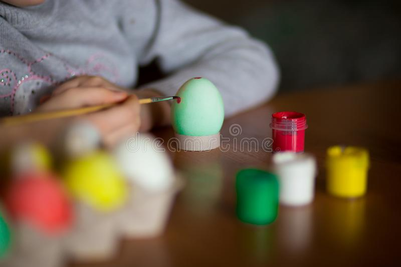 Happy easter. Little girl painter painted eggs. Kid preparing for Easter. Painted hand. Finger paint. Art and craft concept. Traditional spring holiday food royalty free stock photos