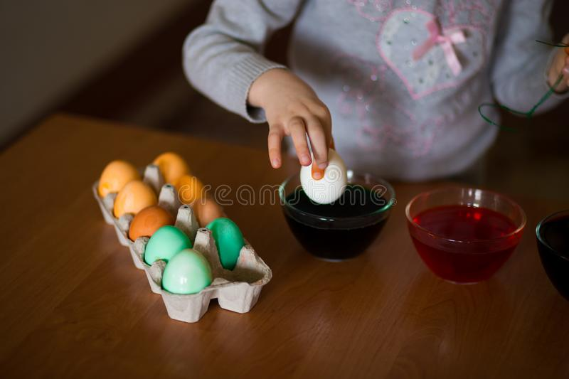 Happy easter. Little girl painter painted eggs. Kid preparing for Easter. Painted hand. Finger paint. Art and craft concept. Traditional spring holiday food stock photos