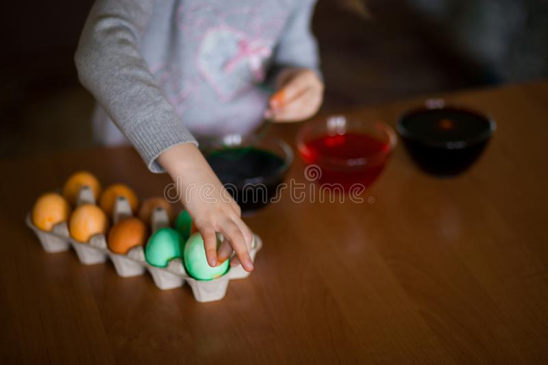 Happy easter. Little girl painter painted eggs. Kid preparing for Easter. Painted hand. Art and craft concept. Tradi. Happy easter. Little girl painter painted royalty free stock images