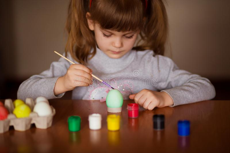 Happy easter. Little girl painter painted eggs. Kid preparing for Easter. Painted hand. Art and craft concept. Tradi. Happy easter. Little girl painter painted royalty free stock photos