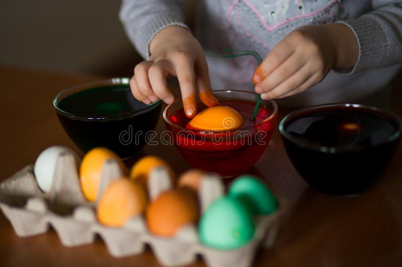 Happy easter. Little girl painter painted eggs. Kid preparing for Easter. Painted hand. Art and craft concept. Tradi. Happy easter. Little girl painter painted royalty free stock photo