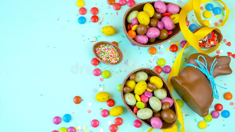 Happy Easter overhead with chocolate Easter eggs and decorations and copy space. Happy Easter overhead with chocolate Easter eggs and decorations on a wood royalty free stock photo