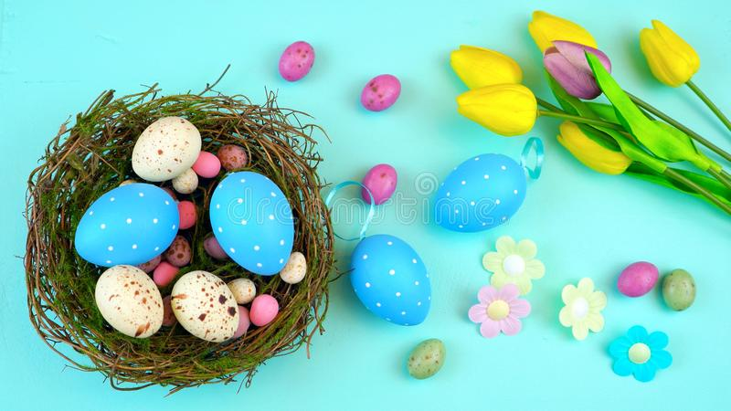 Happy Easter overhead with Easter eggs and decorations stock photography
