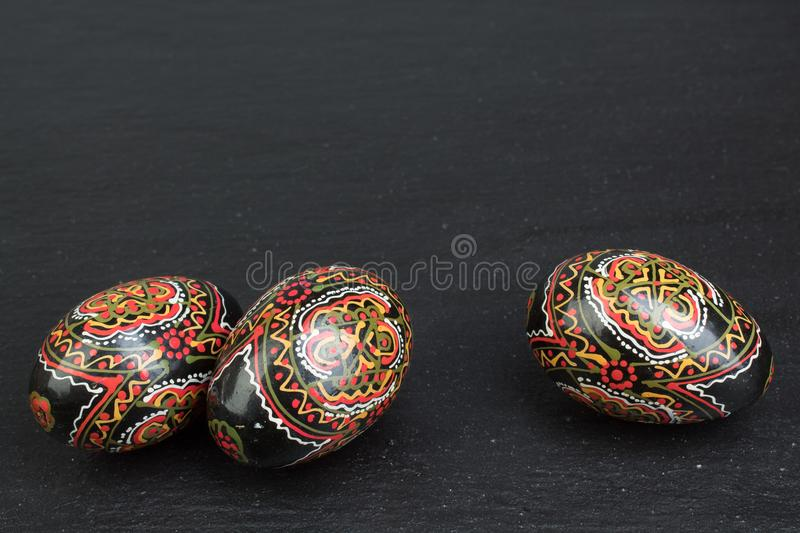 Happy Easter. Painted eggs on black background. Top view. Copy space for text. royalty free stock images