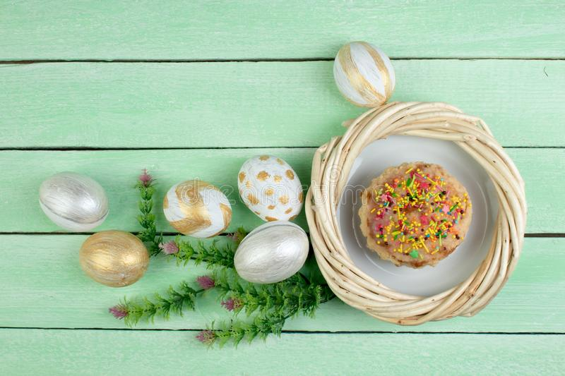 Happy Easter. Painted eggs on wooden table. Easter Cake - Russian and Ukrainian Traditional Kulich, Paska Easter Bread royalty free stock images