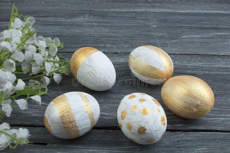 Happy Easter. Painted eggs on wooden table. Top view. Copy space for text. stock photo